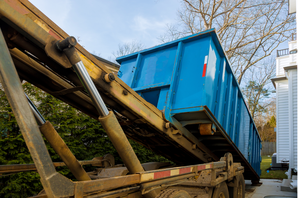 Rental dumpster being delivered at a house in East Troy, Wisconsin